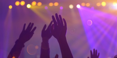 hands in air at concert klu digital